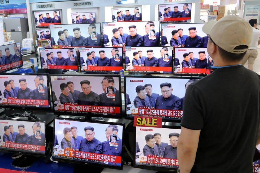 A man watching a news report about North Korea's latest nuclear test, in Seoul on Sept 3, 2017.