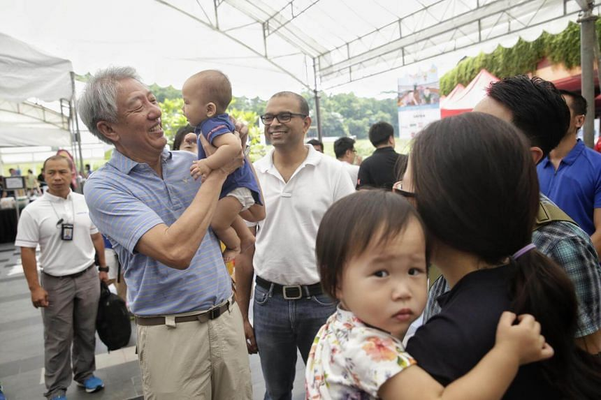 "DPM Teo Chee Hean carrying seven-month-old Reagan Choe at the ""My Family Fiesta - Making Singapore a Great Place for Families"" event on Sept 3, 2017."