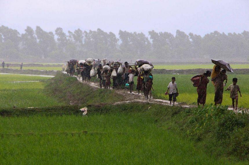 Rohingya refugees from Myanmar's Rakhine state walking near Teknaf in Bangladesh on Sept 2, 2017.