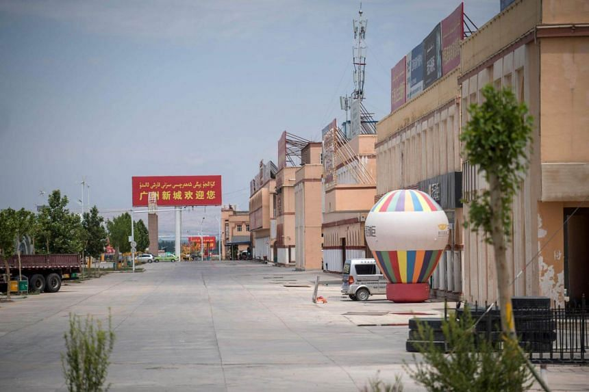 """An empty street in Guangzhou New City, a 1.5 million square metre """"urban centre"""" on the outskirts of Kashgar, Xinjiang province, on June 25, 2017."""