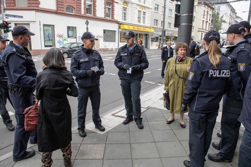 German police speaking with residents during evacuation operations in Frankfurt on Sept 3, 2017.