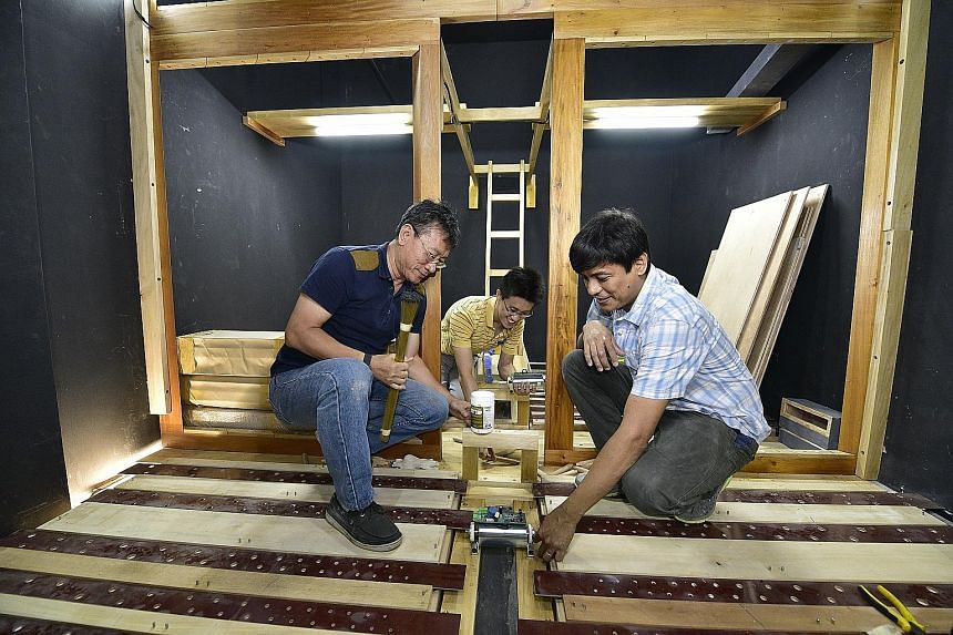 From left: Carillon Technology Singapore director Roster Wu, his son, Mr Ryn Aldrige Wu, and Diego Cera organ-builder Cealwyn Tagle inside the chamber of the pipe organ being installed at Dulwich College (Singapore).