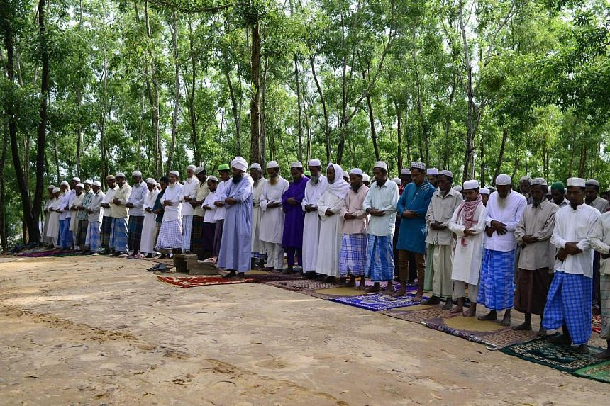 Rohingya refugees performing Eid prayers at Kutupalong refugee camp near the Bangladesh-Myanmar border yesterday. Rohingya fleeing to Bangladesh claim the Myanmar army is trying to force them out.