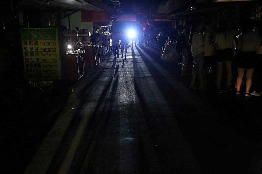 Taipei in darkness during a power outage on Aug 15. A human error shut down six generators in a government-owned utility's power plant, which resulted in a 10 per cent cut in Taiwan's power-generation capacity.