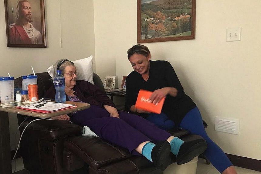 Ms Marleen Brooks visiting Ms Wanda Mills in the nursing home. Ms Mills had written to Ms Brooks asking for friendship and saying she was lonely and scared.