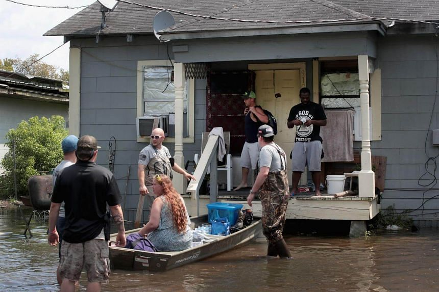 Members of the Wounded Veterans of Oklahoma help rescue flood victims after torrential rains pounded Southeast Texas following Hurricane and Tropical Storm Harvey.