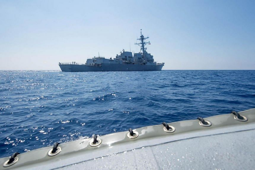 Arleigh Burke-class guided-missile destroyer USS Dewey transits the South China Sea on May 6, 2017.