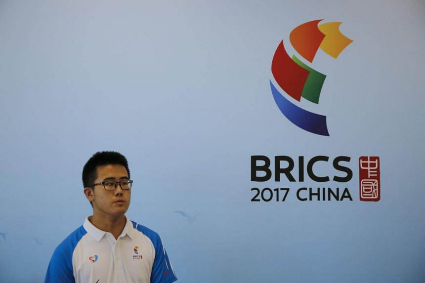 A Chinese volunteer works at the media reception area for the 2017 BRICS Summit in Xiamen, on Sept 2, 2017.