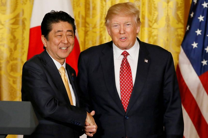 Japanese Prime Minister Shinzo Abe (left) and US President Donald Trump shake hands following their joint press conference at the White House in Washington, on Feb 10, 2017.