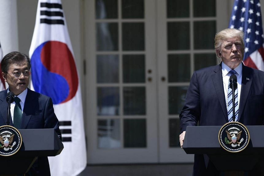 US President Donald Trump and South Korean President Moon Jae In attend a joint press conference in the Rose Garden at the White House in Washington, DC, on June 30, 2017.