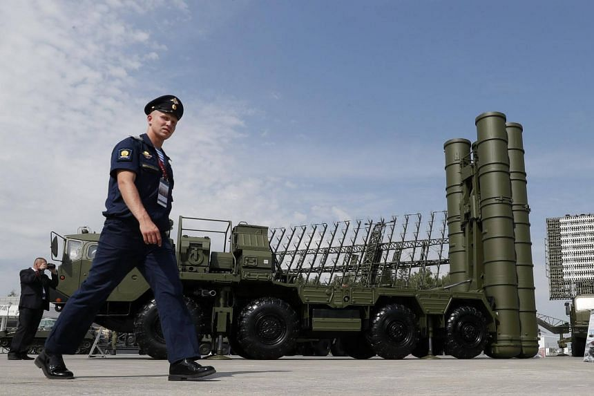 A Russian military official walks in front of the S-400 Triumph anti-aircraft missile system on Aug 22, 2017.