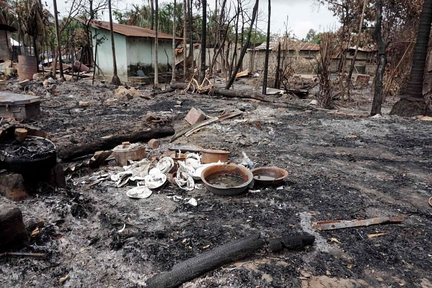 Broken dishes are seen in the burned out remains of a house in Myo Thu Gyi Muslim village in northern Rakhine State on Aug 31, 2017.