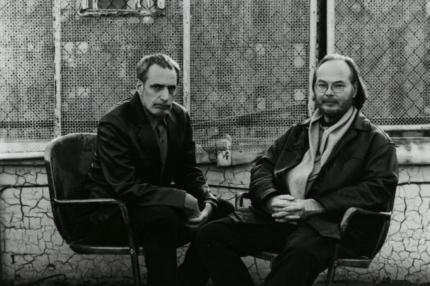 Walter Becker (right) poses his Steely Dan partner and co-founder Donald Fagen in 2005.