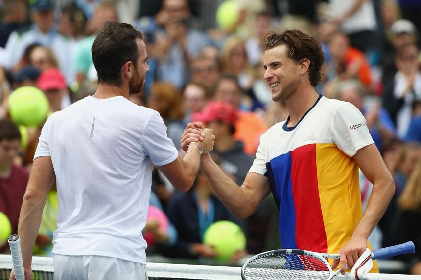 Thiem (right) shakes hands with Adrian Mannarino of France after defeating him in their third round match.