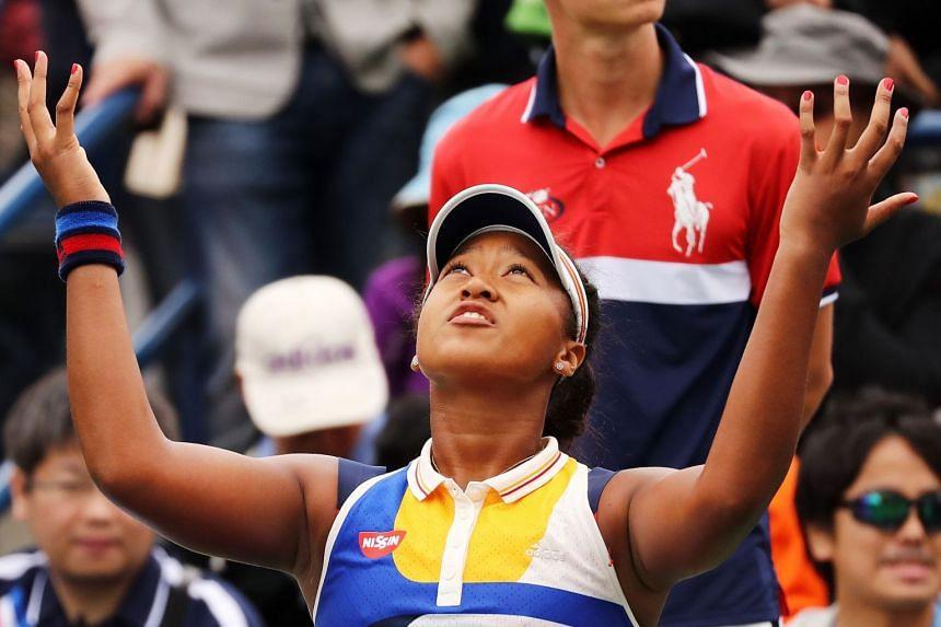 Osaka reacts during her third round match against Kaia Kanepi of Estonia.