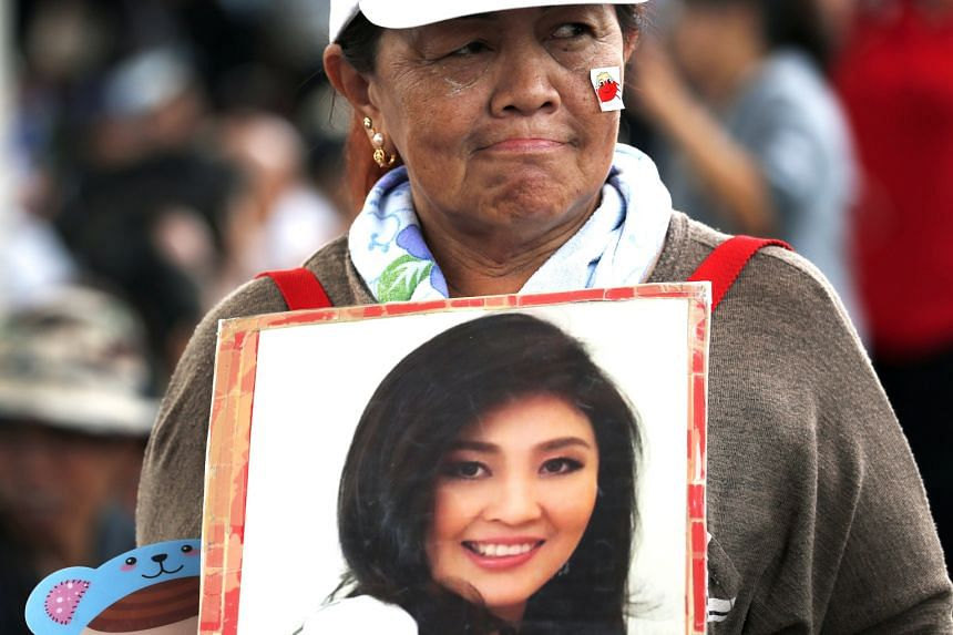 A supporter of Yingluck Shinawatra at the Supreme Court on Aug 25, where she failed to show up for the verdict reading.
