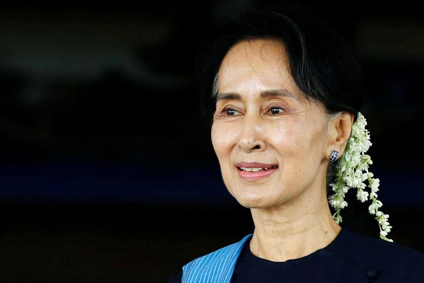 Myanmar's Foreign Minister Aung San Suu Kyi smiles after a meeting with Norway's Foreign Minister Borge Brende (not in picture) at Myanmar's Foreign Ministry in Naypyitaw, Myanmar, on July 6, 2017.