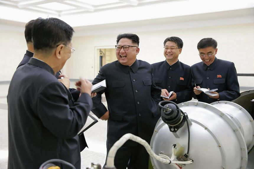 North Korean leader Kim Jong Un speaking with other officials, purportedly on nuclear weaponisation, in a picture released by KCNA on Sept 3, 2017.