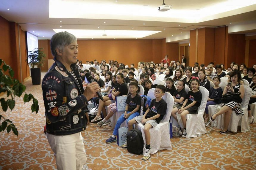 Mr Dick Lee giving the opening address to ChildAid performers at Resorts World Sentosa on Sept 4, 2017.