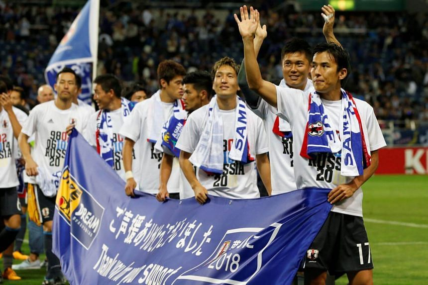 Japan's players wave to fans after winning the World Cup 2018 Qualifiers on Aug 31, 2017.