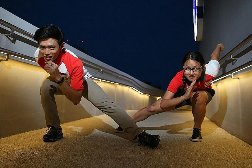 Lucas Ng and Cheyenne Goh reprising their speed skating stance at the Sports Hub yesterday. It is unclear if he will return to Korea to train while she has delayed her studies by a year.