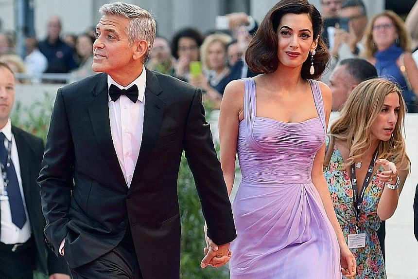 George Clooney (left) with his wife Amal.