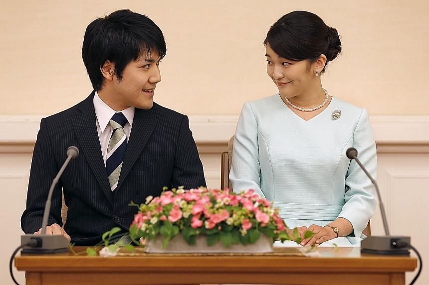 Princess Mako and her fiance Kei Komuro at a press conference to announce their engagement in Tokyo yesterday.