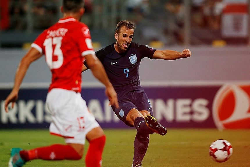 Harry Kane scoring the first of his two goals in England's 4-0 victory against Malta last Friday. The striker now has five goals in his last three international outings and his form will be crucial to manager Gareth Southgate's tactics in today's Wor