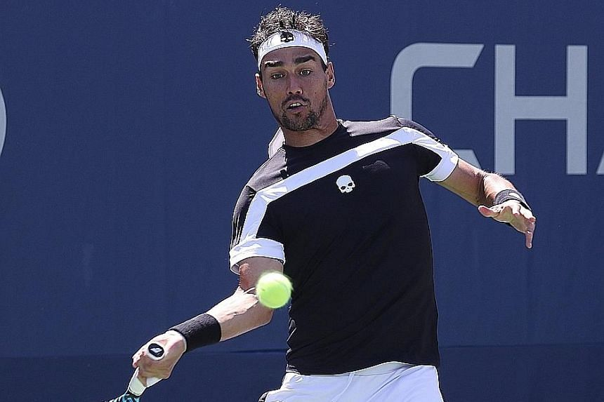 Fabio Fognini returning during his loss to fellow Italian Stefano Travaglia. The organisers waited days for a translation of his slurs against the umpire before throwing him out of the US Open.