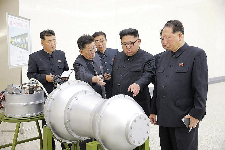 """North Korean leader Kim Jong Un """"giving guidance"""" on the nuclear weapons programme in this undated photo released by North Korea's Korean Central News Agency yesterday. Though he has been in power for nearly six years, Mr Kim remains something of an"""