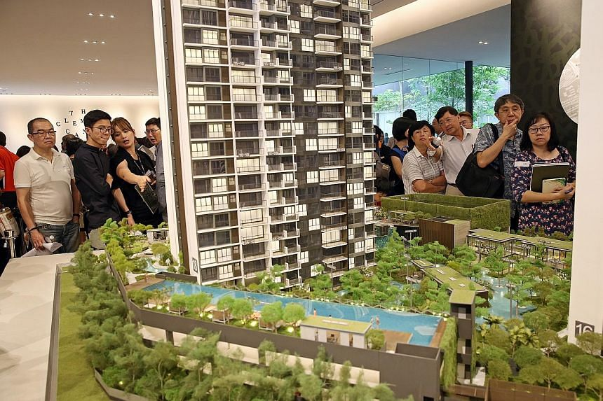 Prospective home buyers at the launch of UOL's Clement Canopy in February. Their ranks could be boosted by a resurgence in collective sale transactions this year, as displaced households needing to relocate check out what the market has to offer.