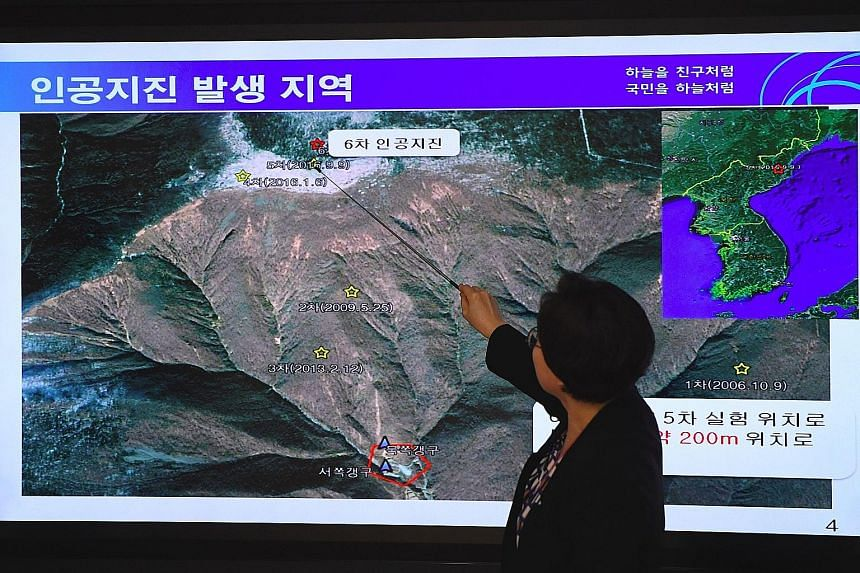 An official from the National Earthquake and Volcano Centre in Seoul yesterday showing the location of an earthquake in North Korea, believed to be where the North conducted its latest nuclear test.