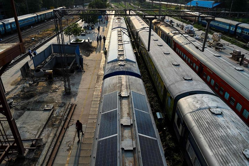 A solar-powered train parked at Sarai Rohilla railway station in New Delhi. India is trying to reduce its massive carbon footprint and modernise its vast colonial-era rail network.