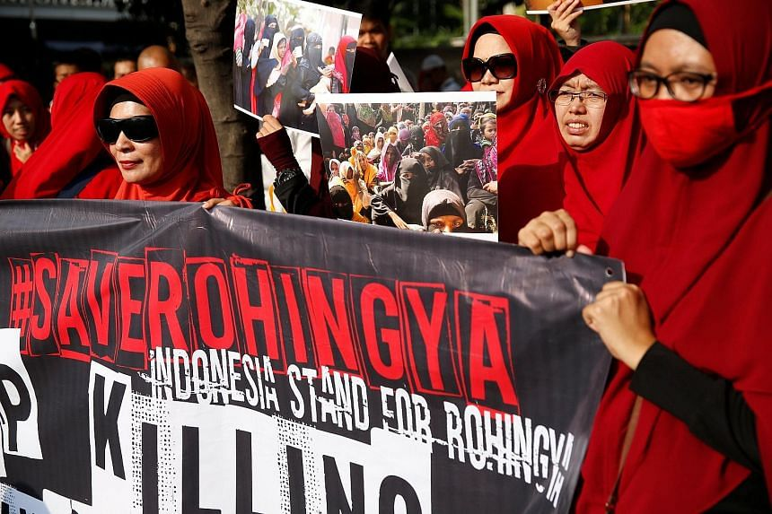 Protesters in support of Myanmar's Rohingya community in Jakarta yesterday. Another rally had been held at the Myanmar embassy the day before. A small fire broke out at the embassy in the early hours yesterday after a petrol bomb was hurled at it.