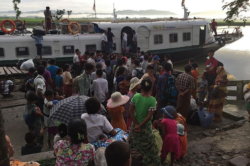 Rohingya refugees leaving Buthidaung jetty in Myanmar. Aid agencies estimate that 73,000 Rohingya have fled to Bangladesh since violence erupted last week.