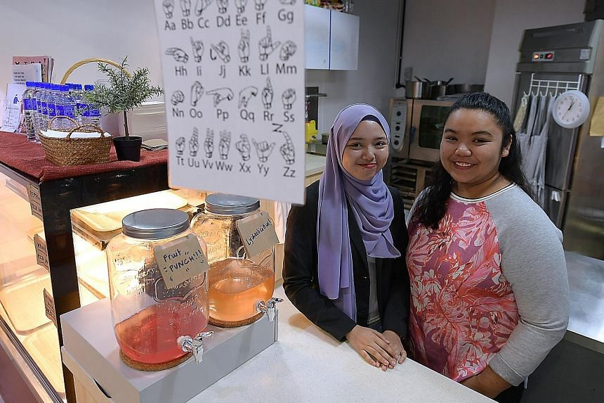 Miss Suzana Slemat (left), 19, and Miss Shazlina Sulaiman, 20, hope to raise awareness of the challenges of the deaf community in Singapore through their cafe.
