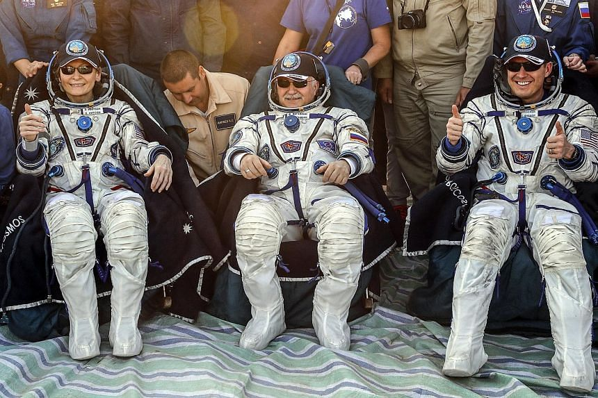 Biochemist Peggy Whitson and her crew mates, Russian space agency Roscosmos' Fyodor Yurchikhin (centre) and fellow Nasa astronaut Jack Fischer, resting shortly after landing the Soyuz MS-04 space capsule in Kazakhstan yesterday morning. Among her oth