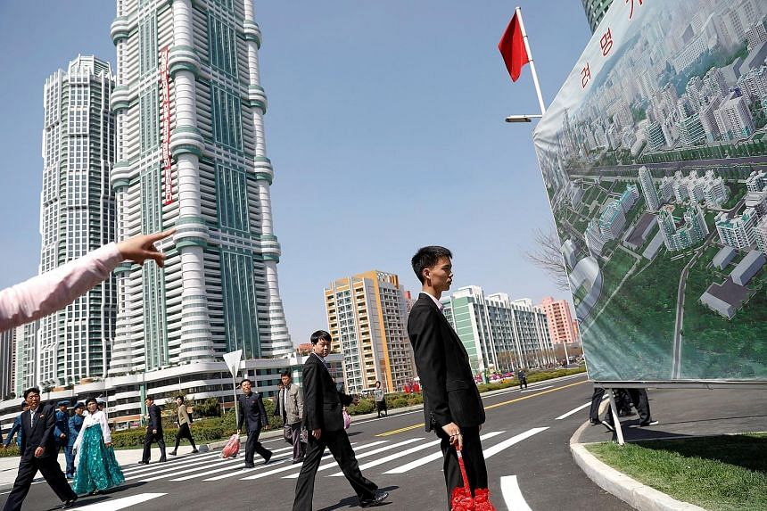 Visitors taking a tour of a new residential complex in Pyongyang in April. New housing in high-rises is generally assigned by profession.