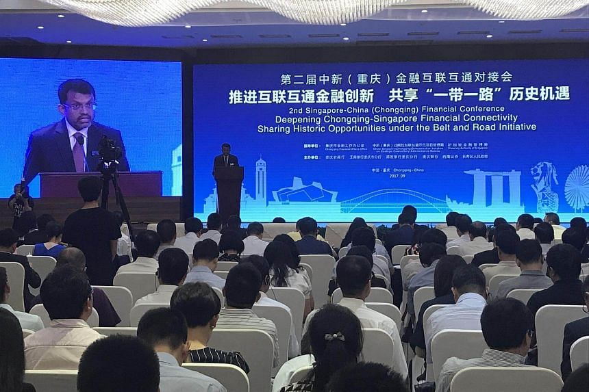 Monetary Authority of Singapore managing director Ravi Menon giving a keynote speech at the opening of the 2nd Singapore-China (Chongqing) Financial Conference on Monday (Sept 4).