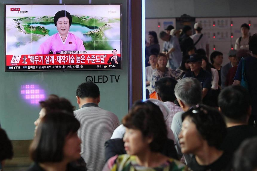 South Koreans watch a television news broadcast about North Korea conducting a H-bomb test sucessfully, at Seoul Station, on Sept 3, 2017.