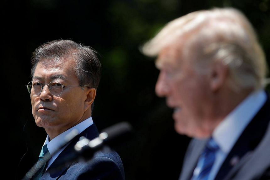 US President Donald Trump and South Korean President Moon Jae In (left) deliver a joint statement from the Rose Garden of the White House in Washington, US on June 30, 2017.