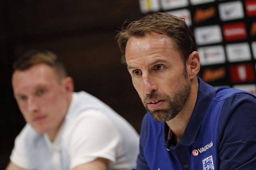 England's manager Gareth Southgate (right) and England's defender Phil Jones attend a press conference, on Sept 3, 2017, ahead of their world cup qualifying football match against Slovakia on Sept 4.
