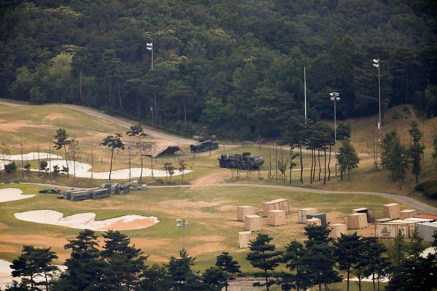 Military vehicles and containers are seen at a golf course where A Terminal High Altitude Area Defense (Thaad) system is deployed, in Seongju, South Korea, on June 13, 2017.