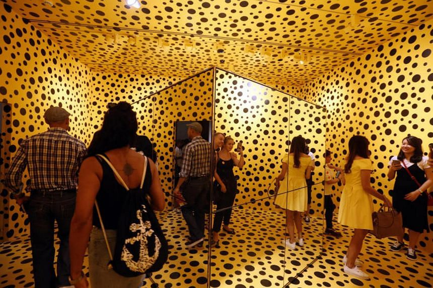 Visitors at Japanese avant-garde artist Yayoi Kusama's Life Is The Heart Of A Rainbow exhibition at the National Gallery Singapore on Sept 3, 2017.