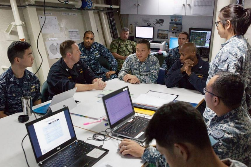 The Republic of Singapore Navy (RSN) personnel in a discussion with United States Navy (USN) personnel on board RSS Stalwart at Exercise Pacific Griffin 2017.