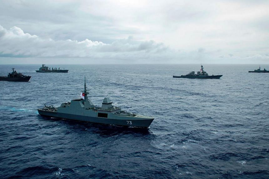 The RSN and USN ships sailing in formation at Exercise Pacific Griffin off the coast of Guam.