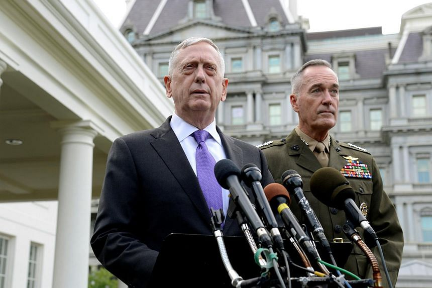 Secretary of Defense James Mattis (left) makes a statement outside the West Wing of the White House in response to North Korea's latest nuclear testing, in Washington, on Sept 3, 2017.