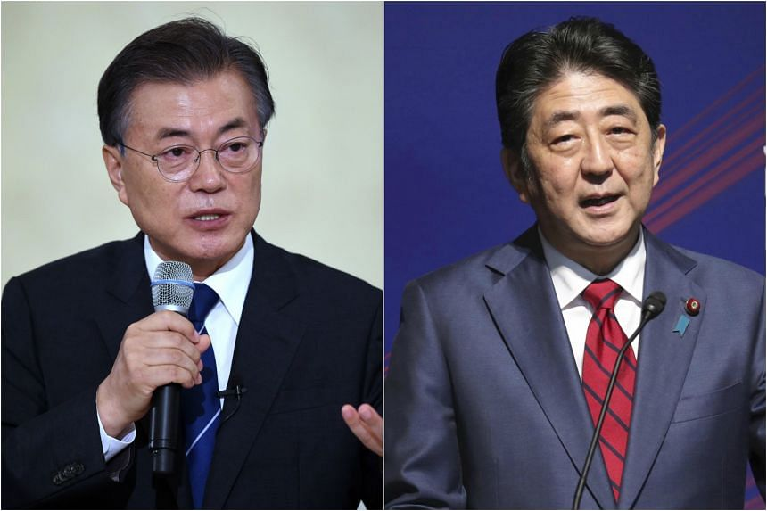 """South Korea's President Moon Jae In (left) and Japanese Prime Minister Shinzo Abe """"agreed to push for more powerful UN sanctions""""."""