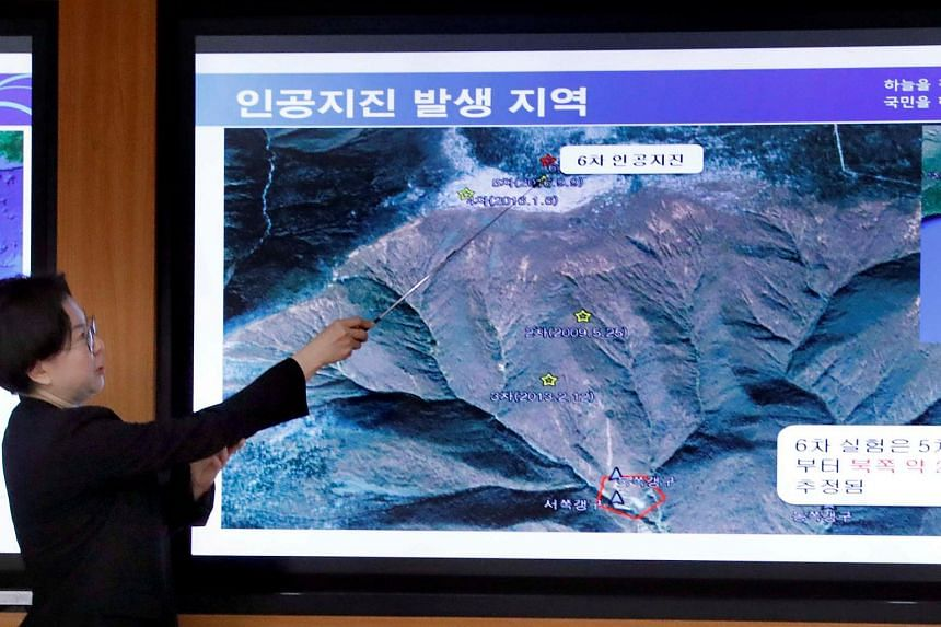 South Korea's Earthquake and Volcano Monitoring Division officer points at where seismic waves were observed at the Korea Meteorological Administration in Seoul, South Korea on Sept 3, 2017.