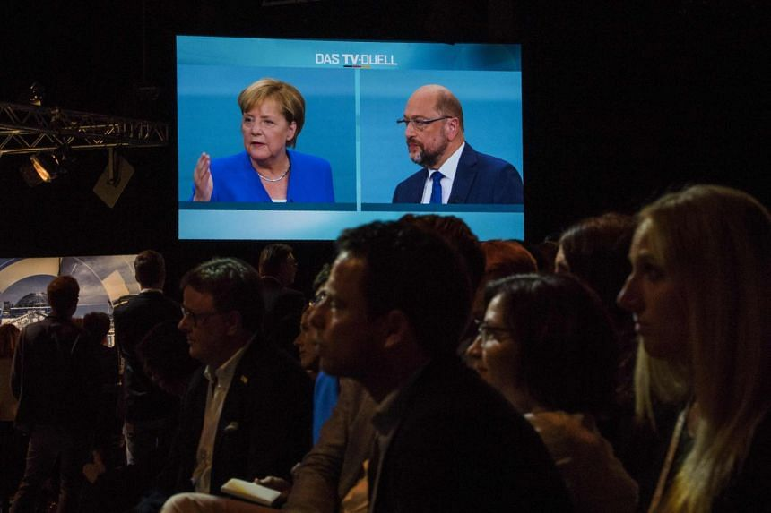 Journalists watch a televised debate between German Chancellor and Mr Martin Schulz at a television studio in Berlin, on Sept 3, 2017.